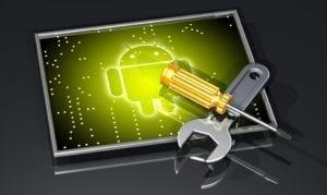 werkzeuge auf leuchtendem android maennchen im bildschirm