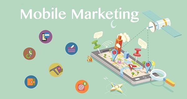 mobile marketing aufschrift ueber smartphone mit symbolen