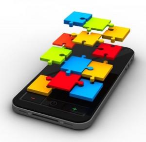 smartphone mit bunten puzzleteilen als bildschirm