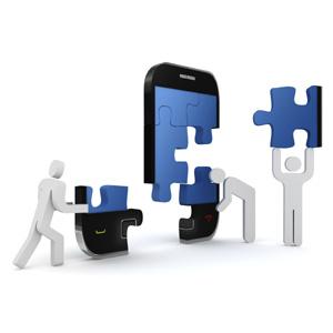 smartphone als puzzleteile mit weissen maennchen